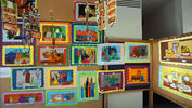 "<p></p><p style=""margin-left: 1em;"">Elementary students show off their artworks</p><p></p>"